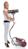 Girl and vacuum cleaner Royalty Free Stock Photos