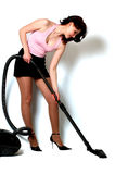 Girl with vacuum cleaner Stock Images