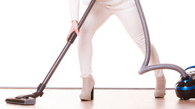 Girl with vacuum cleaner. Housework Royalty Free Stock Photo