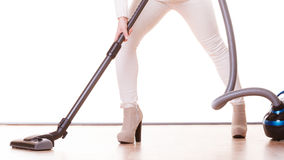 Girl with vacuum cleaner. Housework Stock Photos