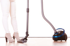 Girl with vacuum cleaner. Housework Stock Images