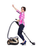Girl with vacuum cleaner Royalty Free Stock Photography