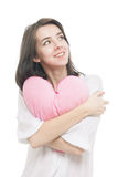 Girl with valentine pink pillow heart Royalty Free Stock Photos