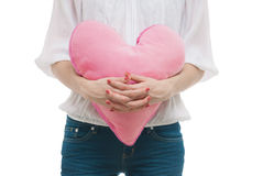 Girl with valentine pink pillow heart Stock Photos