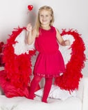 Girl in a Valentine's Day holding a heart Royalty Free Stock Photography