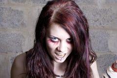 Girl the vampire. The girl the vampire aggressively looks forward Stock Images