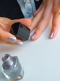 The girl varnishs nails. Manicure Stock Photography