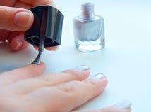The girl varnishs nails Royalty Free Stock Photos