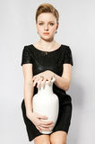 Girl with vase. Young women whis vase. Studio shot royalty free stock photo