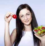 girl with vegetable salad Royalty Free Stock Image