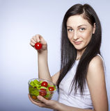 girl with vegetable salad Stock Images