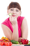 Girl with vegetable on white backg Royalty Free Stock Photos