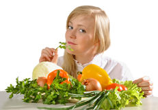 Girl and vegetables Royalty Free Stock Image