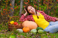 Girl with vegetables Stock Image