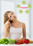 Girl with vegetables choose healthy vitamin foods. Beautiful young woman with vegetables choose healthy foods rich in vitamins stock photography