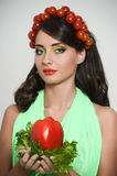 Girl with Vegetables hair style. Beautiful happy young woman with vegetables on her head. Healthy food concept, diet, veget Royalty Free Stock Images