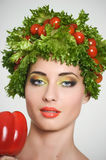 Girl with Vegetables hair style. Beautiful happy young woman with vegetables on her head. Healthy food concept, diet, veget Stock Photos