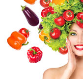 Girl with vegetables hairstyle Stock Image