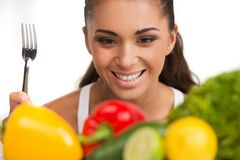 Girl with vegetables isolated on white background. Royalty Free Stock Photography