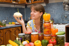 Girl with vegetables and jars. In the kitchen Royalty Free Stock Photo