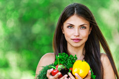 Girl with vegetarian set Royalty Free Stock Photos