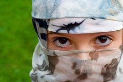 Girl with a veil. Young girl dressed in a veil like a moslem girl, she is not a moslem but this image resembles moslem traditional and fundamentalistic dress Stock Images