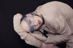 Girl with veil on her face. Portrait of  girl with veil on her face and with a piercing in her chin Royalty Free Stock Image