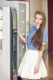 Girl with vending machine. Charming elegant smiling girl with vending machine stock photo