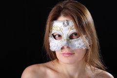 The girl in the Venetian mask. On a black background Royalty Free Stock Photography