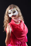 Girl in the Venetian mask. On a black background Stock Photography