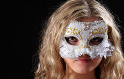 Girl in the Venetian mask. On a black background Royalty Free Stock Photography