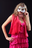 Girl in the Venetian mask. On a black background Royalty Free Stock Photos