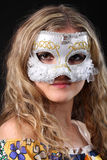 Girl in the Venetian mask. On a black background Royalty Free Stock Images