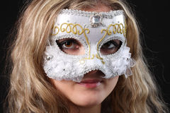 Girl in the Venetian mask. On a black background Stock Photo