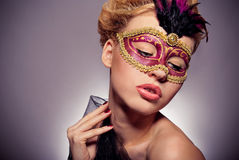 Girl in a Venetian mask Stock Images