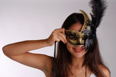 Girl with venetian mask Royalty Free Stock Image