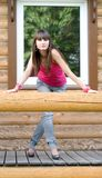 Girl on a veranda Stock Photography