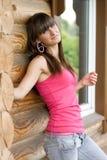 Girl on a veranda Stock Photos