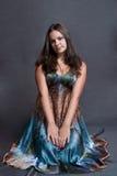Girl in versicolor dress Stock Image