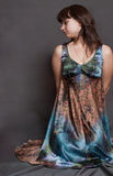 Girl in versicolor dress Stock Images