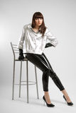 Girl with very long legs in leather pants Stock Image