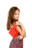 Girl with very small shopping bag Stock Photos