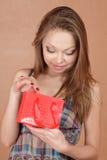 Girl with very small shopping bag Stock Photos