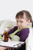 Girl very upset lying in bed with medicine Stock Image