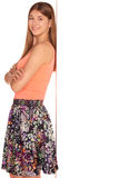 Girl in a vest and skirt behind white wall Royalty Free Stock Image