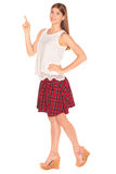 Girl in a vest and skirt behind white wall Stock Photo