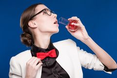 Girl with a vial in his hand and a red butterfly on her neck Stock Image