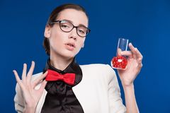 Girl with a vial in his hand and a red butterfly on her neck Royalty Free Stock Photography