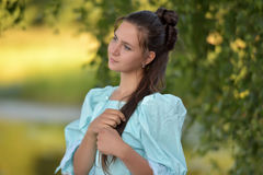 Girl in a Victorian dress. Stock Photos