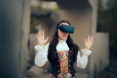 Girl in Costume with VR Glasses in Virtual Reality Concept Portrait stock photo